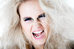 Wildly screaming at you with my white hair. Screaming model with white wild hair Royalty Free Stock Photography