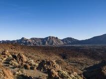 Wildness. Volcanic landscape - mountain range - desert - blue sky - bushes - no people Royalty Free Stock Photo