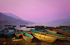 Wilight landscape with boats on Phewa lake Stock Images