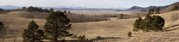Wilkerson Pass panorama. Wide panorama view of the central Rocky Mountains of Colorado in early winter from the summit of Wilkerson Pass near Divide, Colorado Royalty Free Stock Image