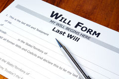 Will. Legal will document with pen, ready to be filled out, on oak desk Royalty Free Stock Images