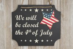 We will be closed the 4th of July Independence Day message. We will be closed he 4th of July text Independence Day on a chalkboard with patriotic USA red and stock image
