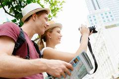 That will be a great picture. Happy young couple as tourists with a camera Royalty Free Stock Image