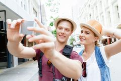 That will be a great picture. Happy young couple as tourists with a camera Stock Images