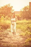 This will be love at first glance. Pregnant woman walking to home. Copy space stock images