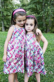 It Will be OK. One young girl comforting another dressed in the same outfit Royalty Free Stock Photo