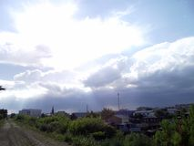 It will be raining soon. Soon there will be rain-clouds passing into the clouds gather over the city closing the sun Royalty Free Stock Photo