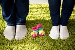 Will be three soon. Three pairs of socks: man, woman and future child Stock Image