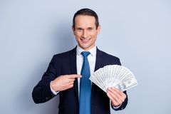 It will become yours! Dream dreamy want wish desire expensive co. St real shopping people person concept. Portrait of glad handsome smart man adverting his deal Royalty Free Stock Photos