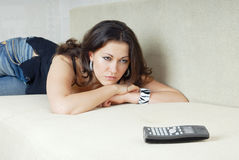 He will call. Sad woman looking at the phone and waiting call Stock Photos