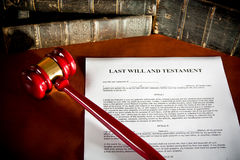 Will concept. Scale, old book, and gavel Stock Photography