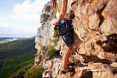 He will conquer this mountain! Stock Photos