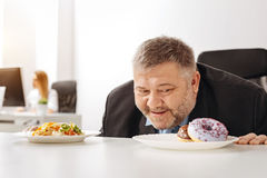 Will less excessive guy cannot resist junk food Royalty Free Stock Photos