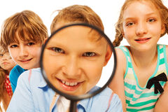 We will find all close shot of boy with magnifier Stock Image