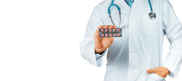 This Will Help. Doctor Holding Blisters With Red Pills, Close-up Stock Image