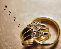 Will It Last Forever?. A set of wedding rings attached together with an unspoken question.  Will it last forever Stock Images
