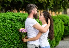 He will never let her go. Man fall in love with gorgeous girl. Man bearded hipster hugs woman. Strong romantic feelings. Become true love. Couple in love hugs royalty free stock photo