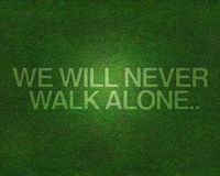 We will never walk alone on grass Stock Image