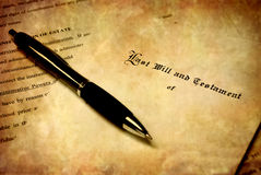 Will with Pen. Pen laying on top of a Will for estate planning Royalty Free Stock Photo