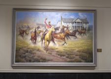 Will Rogers on horseback painting  Claremore, Oklahoma. Pictured is a painting of Will Rogers riding a horse and twirling his rope in the Will Rogers Memorial Stock Image