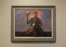 Will Rogers oil on canvas painting, Claremore, Oklahoma. Pictured is a painting of Will Rogers on horseback tipping his hat in the Will Rogers Memorial Museum in Stock Images