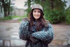 Will rub girls in an old military helmet of times World War II Stock Photo