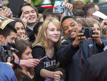 Will Smith. MOSCOW, RUSSIA - MAY 27: Will Smith takes photo with a fan during a photocall for the film After Earth on May 27, 2013 in Moscow Stock Photography