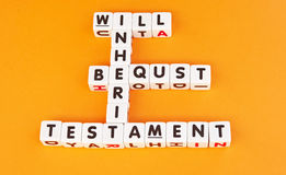 Will, testament and bequest. Text ' will, inherit, bequest,  testament ' combined crossword style in black letters on white cubes , gold background Royalty Free Stock Image