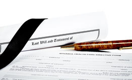 Will and Testament with Glasses Pen and Income Tax Return Stock Photo