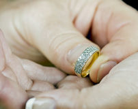 Will you. Man and Womans hands in a Marry me gesture. Main focus is on the ring Royalty Free Stock Image