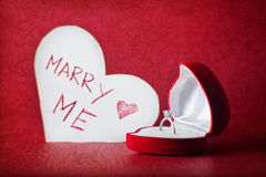 Will you marry me. Red box with diamond ring and card with text on red background Royalty Free Stock Images