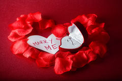 Will you marry me. Red box with diamond ring and card with text on red background Royalty Free Stock Photos
