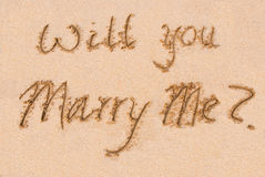 Will you marry me?. Written out on the sand Stock Photos