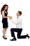 Will you marry me?. Handsome guy on knees proposing girl. Will you marry me Stock Images