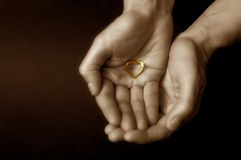 Will You Marry Me?. Hands holding a hart shaped ring royalty free stock images