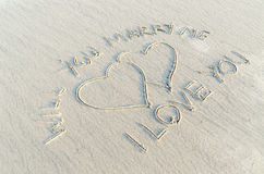 Will you marry me. And Heart drawn on sand. Sign of romantic and love Royalty Free Stock Image