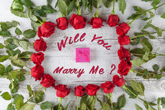 Will you marry me text with roses and gift box. Stock Image