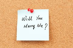 Will you marry me?. Will you marry me words written on paper and pinned on corkboard Stock Photos