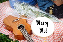 Will you marry me ?. Young couple spending weekend together with guitar Stock Image