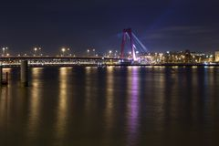 Willemsbrug Bridge and river Meuse at night Royalty Free Stock Photos