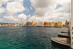 Willemstad in Curacao and the Queen Emma Bridge. The Queen Emma Bridge is a pontoon bridge across St. Anna Bay in Curaçao. It connects the Punda and Otrobanda Stock Images
