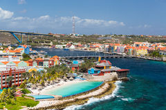 Willemstad in Curacao and the Queen Emma Bridge. The Queen Emma Bridge is a pontoon bridge across St. Anna Bay in Curaçao. It connects the Punda and Otrobanda Royalty Free Stock Photos