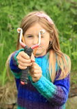 Willful girl with a slingshot Royalty Free Stock Image