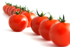 Willful tomato. One step forward by one tomato, isolated on white Stock Photos