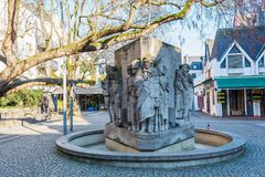 Willi Ostermann fountain memorial in the old town of Cologne, Germany. Cologne, Germany - February 24, 2018: Willi Ostermann fountain memorial in the old town of Royalty Free Stock Photography