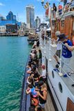 Historic boat, crowded with people, returning to Port of Auckland, New Zealand stock images