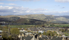 William Wallace tower above Stirling, Scotland. Stirling, Scotland has been inhabited for nearly a thousand years.  The tower at the summit of Abbey Craig, near Royalty Free Stock Image