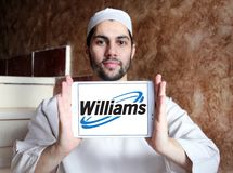 Williams Companies logo. Logo of Williams Companies on samsung tablet holded by arab muslim man. The Williams Companies, Inc. is an energy company, its core Royalty Free Stock Photo