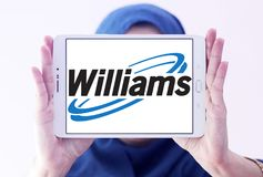 Williams Companies logo. Logo of Williams Companies on samsung tablet holded by arab muslim woman. The Williams Companies, Inc. is an energy company, its core Stock Images