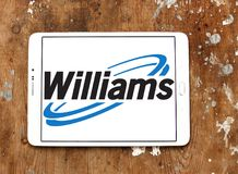 Williams Companies logo. Logo of Williams Companies on samsung tablet on wooden background. The Williams Companies, Inc. is an energy company, its core business Royalty Free Stock Image